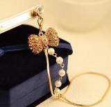 满钻珍珠蝴蝶结链条手机防尘塞白钻